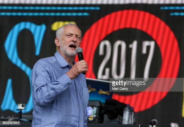 Labour Party leader Jeremy Corbyn address the crowd from the main stage a the Glastonbury Festival site at Worthy Farm in Pilton on June 24 2017 near...