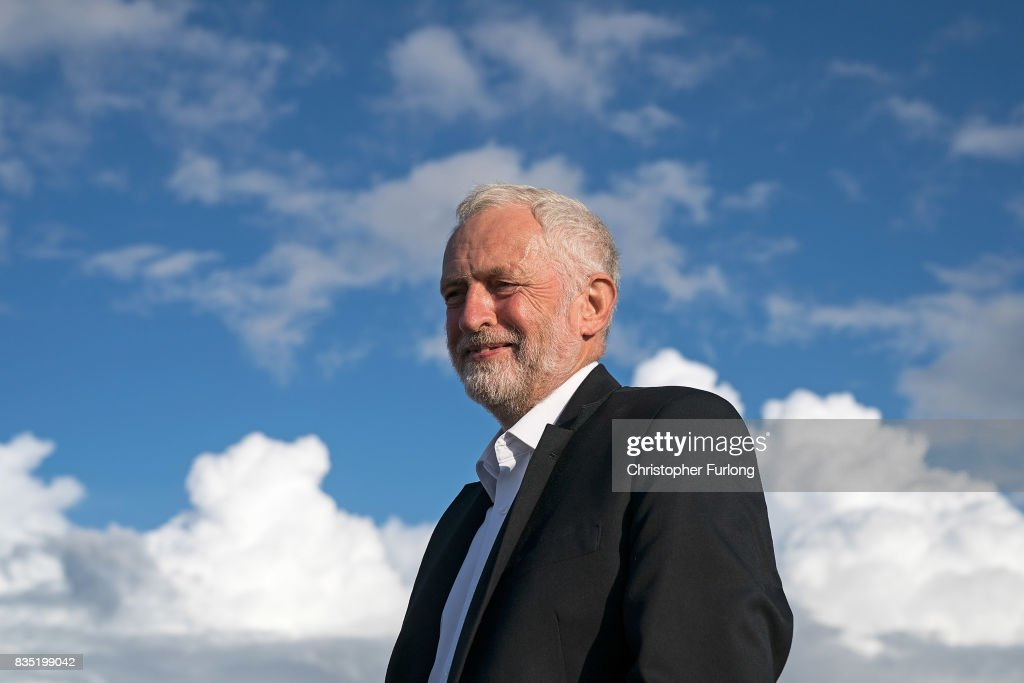 Labour Party Leader Jeremy Corbyn addresses supporters during a rally on the beach on August 18, 2017 in Southport, England. Jeremy Corbyn is in the north west as part of his UK wide tour visiting marginal seats.
