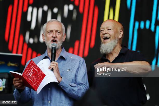 Labour party leader Jeremy Corbyn addresses the crowd alongside Glastonbury organiser Michael Eavis on the Pyramid Stage as he makes a guest...