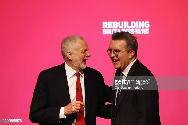 Labour Party leader Jeremy Corbyn and Deputy Leader of the Labour Party Tom Watson share a joke on day four of the Labour Party conference at the...