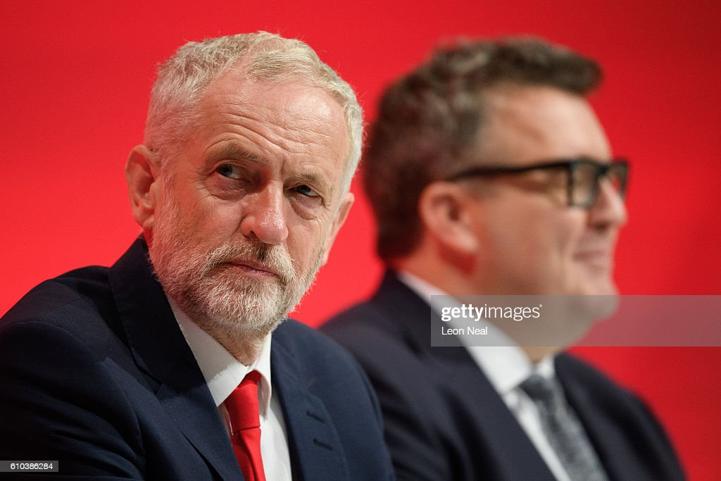 Labour party leader Jeremy Corbyn (L) and Deputy leader Tom Watson sit in the main hall on the first day of the Labour Party Conference in the Exhibition Centre Liverpool on September 25, 2016 in Liverpool, England. Party leader Jeremy Corbyn will hope to re-unite the party after being re-elected leader yesterday.