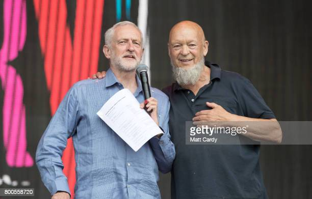 Labour Party leader Jeremy Corbyn and festival founder Michael Eavis address the crowd from the main stage a the Glastonbury Festival site at Worthy...