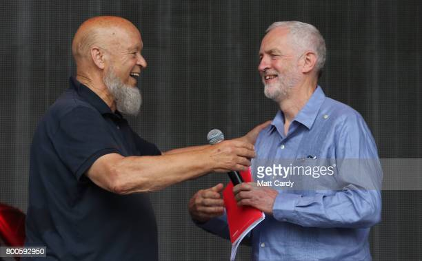 Labour Party leader Jeremy Corbyn and festival founder Michael Eavis address the crowd from the main stage at the Glastonbury Festival site at Worthy...