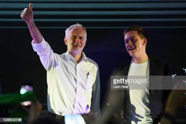 Labour Party leader Jeremy Corbyn and writer Owen Jones smile to the audience at a Momentum The World Transformed event during the first day of the...