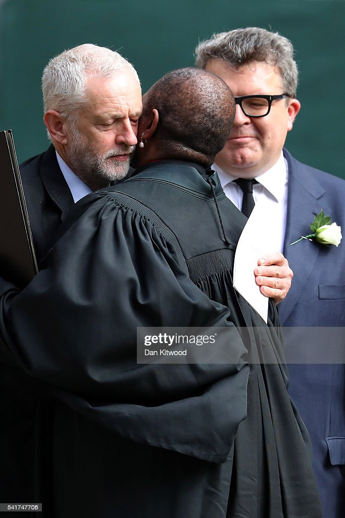 Labour party leader Jeremy Corbyn (L) embraces a member of the clergy as Tom Watson, Deputy Leader of the Labour Party looks on at St Margaret's church on June 20, 2016 in London, England. Parliament was recalled from recess today so MPs could pay tribute to Jo Cox, Labour MP for Batley and Spen, who was murdered in her constituency last Thursday.