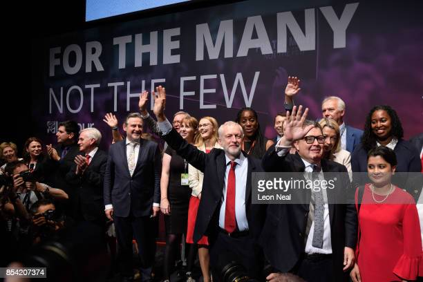 Labour Party leader Jeremy Corbyn gestures to delegates as he stands with members of the Shadow Cabinet at the end of the third day of the Labour...