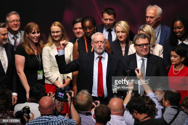 Labour party leader Jeremy Corbyn gestures to delegates in the main hall as Shadow Secretary of State for Education Angela Rayner Deputy Labour party...