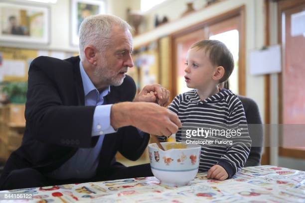 Labour Party Leader Jeremy Corbyn helps Booby O'Neill aged three to make cakes during his visit to the Pen Green Centre on September 8 2017 in Corby...