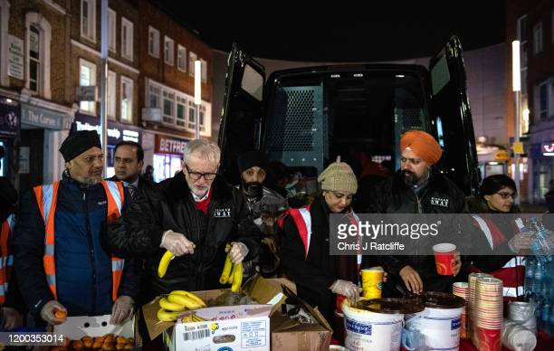 Labour party leader Jeremy Corbyn helps volunteers from Sikh Homeless charity Nishkam Swat hand out food to the homeless on Slough High Street on...