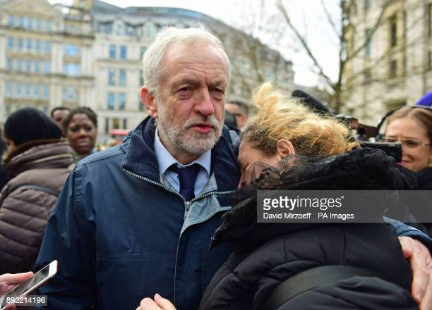 Labour Party leader Jeremy Corbyn hugs a woman after the Grenfell Tower National Memorial Service at St Paul's Cathedral in London to mark the six...