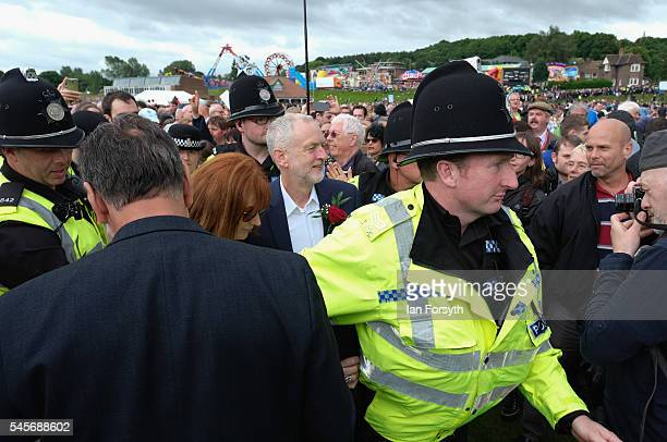 Labour Party leader Jeremy Corbyn is escorted by police through enthusiastic crowds following his appearance at the 132nd Durham Miners Gala on July...