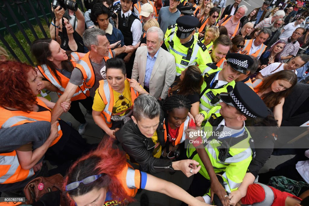 Labour Party leader Jeremy Corbyn is escorted through the crowd by police after speaking to demonstrators during the 'Not One Day More' march at Parliament Square on July 1, 2017 in London, England. Thousands of protesters joined the anti-Tory demonstration at BBC Broadcasting House and marched to Parliament Square. The demonstrators were calling for an end to the Conservative Government and policies of austerity.