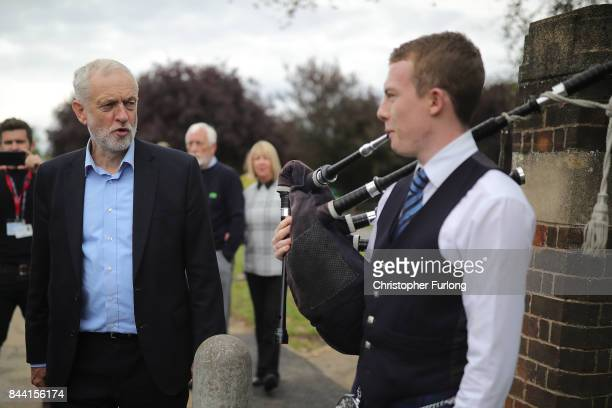 Labour Party Leader Jeremy Corbyn is greeted by a piper as he arrives at the Pen Green Centre on September 8 2017 in Corby England The Pen Green...