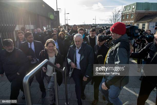 Labour Party leader Jeremy Corbyn is mobbed by television reporters during a visit to StokeOnTrent after last night's victory in the byelection on...