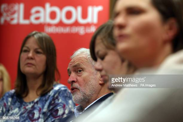 Labour party leader Jeremy Corbyn listens to NHS staff at Park South Community Centre in Swindon during a talk about the NHS winter crisis