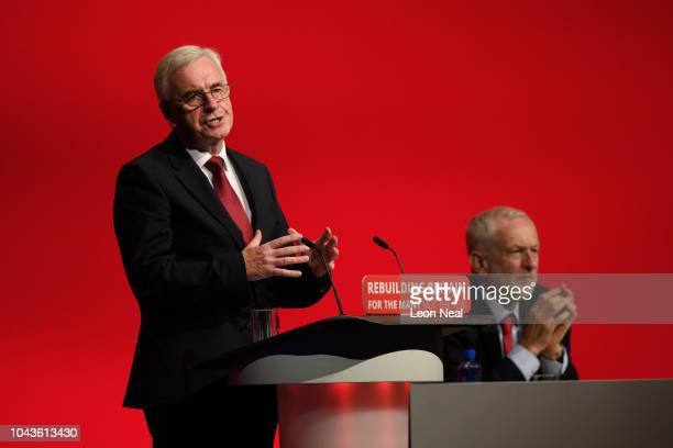 Labour Party leader Jeremy Corbyn looks on as Shadow Chancellor of the Exchequer John McDonnell addresses delegates in the Exhibition Centre...