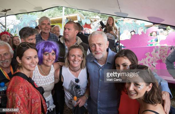 Labour Party leader Jeremy Corbyn meets festival goers as he visits the Green Fields at the Glastonbury Festival site at Worthy Farm in Pilton on...