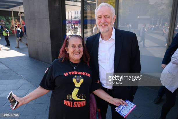 Labour Party leader Jeremy Corbyn poses for a picture with a supporter following a demonstration calling for the renationalisation of the rail...