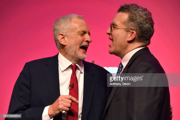 Labour Party leader Jeremy Corbyn shares a laugh with Deputy Leader Tom Watson after delivering the keynote speech during the Labour Party annual...