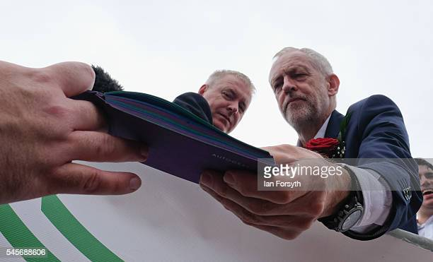 Labour Party leader Jeremy Corbyn signs autographs for supporters following his speech during the 132nd Durham Miners Gala on July 9 2016 in Durham...