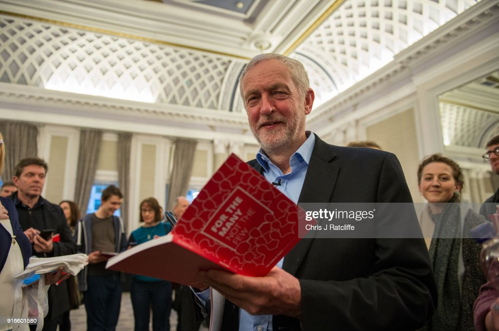 Labour Party leader Jeremy Corbyn signs his manifesto for the winner of a raffle after speaking at a Labour Party conference on alternative models of ownership on February 10, 2018 in London, England. After the collapse of Carillion and the East Coast rail scandal, Labour Party leader Jeremy Corbyn and Shadow Chancellor John McDonnell both address a Labour conference on expanding public and democratic ownership in the economy.