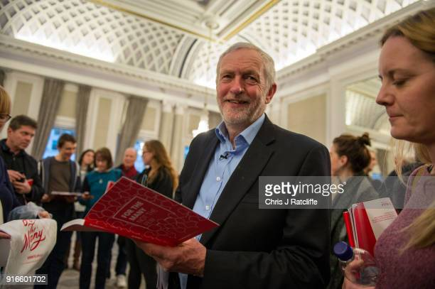 Labour Party leader Jeremy Corbyn signs his manifesto for the winner of a raffle after speaking at a Labour Party conference on alternative models of...