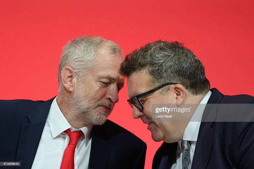 Labour Party leader Jeremy Corbyn (L) sits with Deputy leader Tom Watson on the first day of the Labour Party Conference the Exhibition Centre Liverpool on September 25, 2016 in Liverpool, England. Party leader Jeremy Corbyn will hope to re-unite the party after being re-elected leader yesterday.