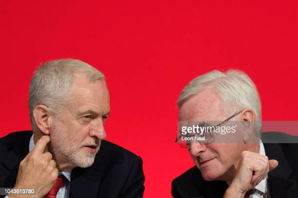 Labour Party leader Jeremy Corbyn sits with Shadow Chancellor of the Exchequer John McDonnell ahead of McDonnell's speech to delegates in the...