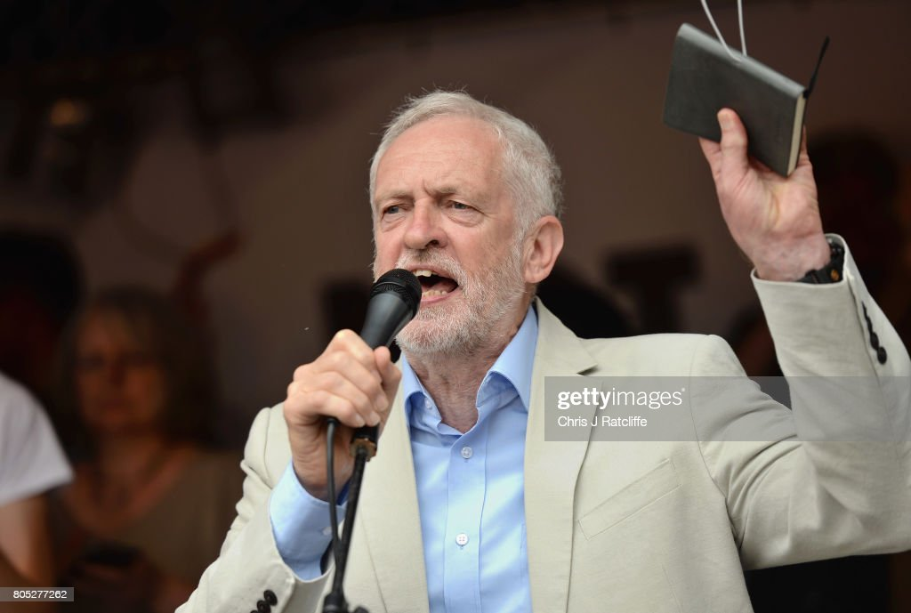 Labour Party leader, Jeremy Corbyn speaks to demonstrators during the 'Not One Day More' march at Parliament Square on July 1, 2017 in London, England. Thousands of protesters joined the anti-Tory demonstration at BBC Broadcasting House and marched to Parliament Square. The demonstrators were calling for an end to the Conservative Government and policies of austerity.