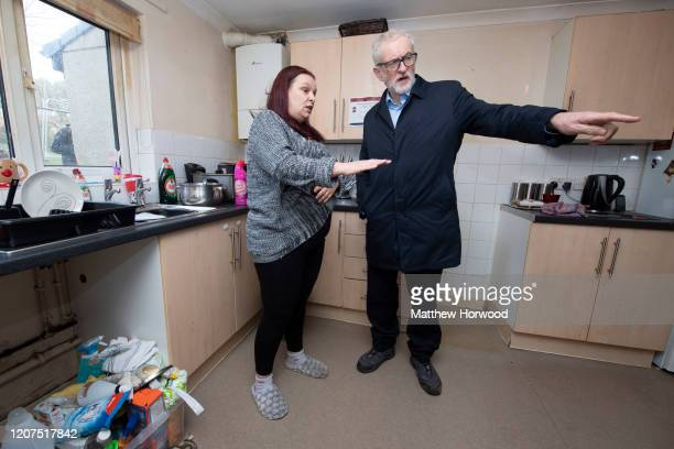 Labour Party leader Jeremy Corbyn speaks with Theresa Davies whose home was flooded on February 20 2020 in Rhydyfelin Wales Residents and business...