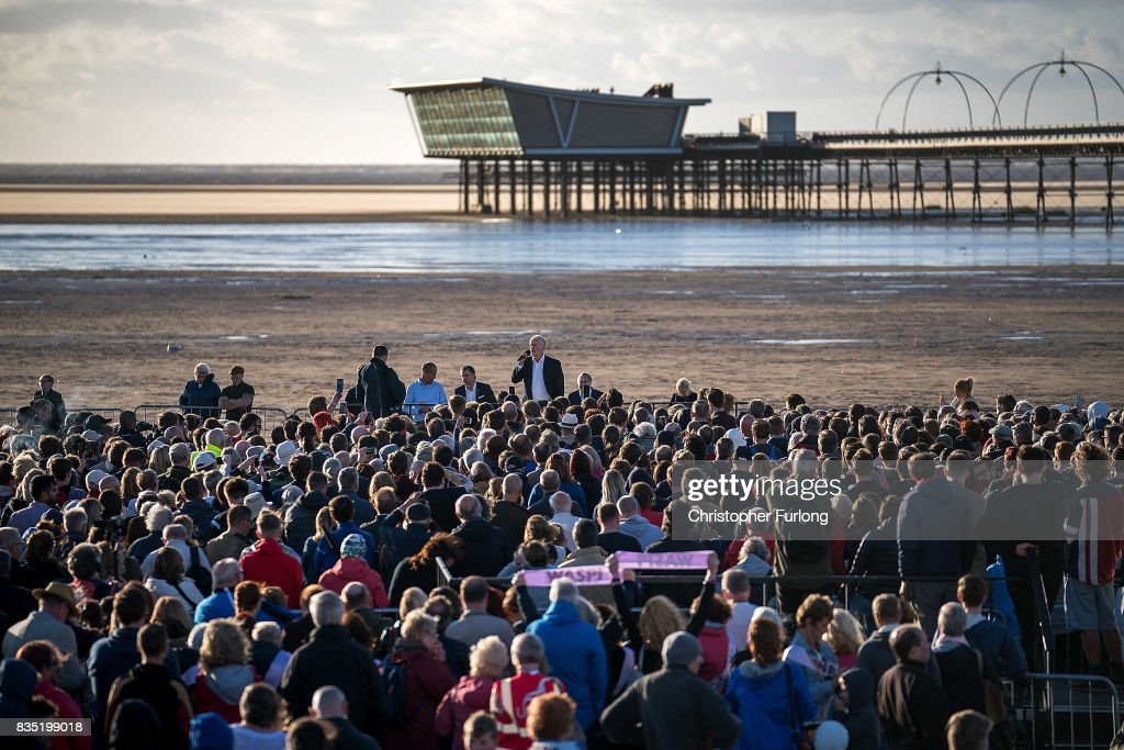 Labour Party Leader Jeremy Corbyn talks to supporters during a rally on the beach on August 18, 2017 in Southport, England. Jeremy Corbyn is in the north west as part of his UK wide tour visiting marginal seats.