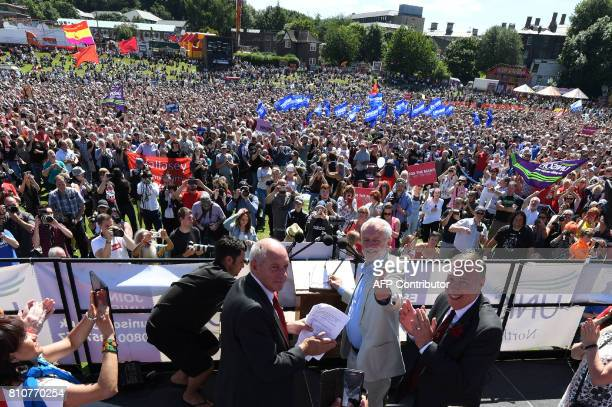 Labour Party leader Jeremy Corbyn turns to greet supporters as he addresses a rally at the Durham Miners Gala in Durham north east England on July 8...