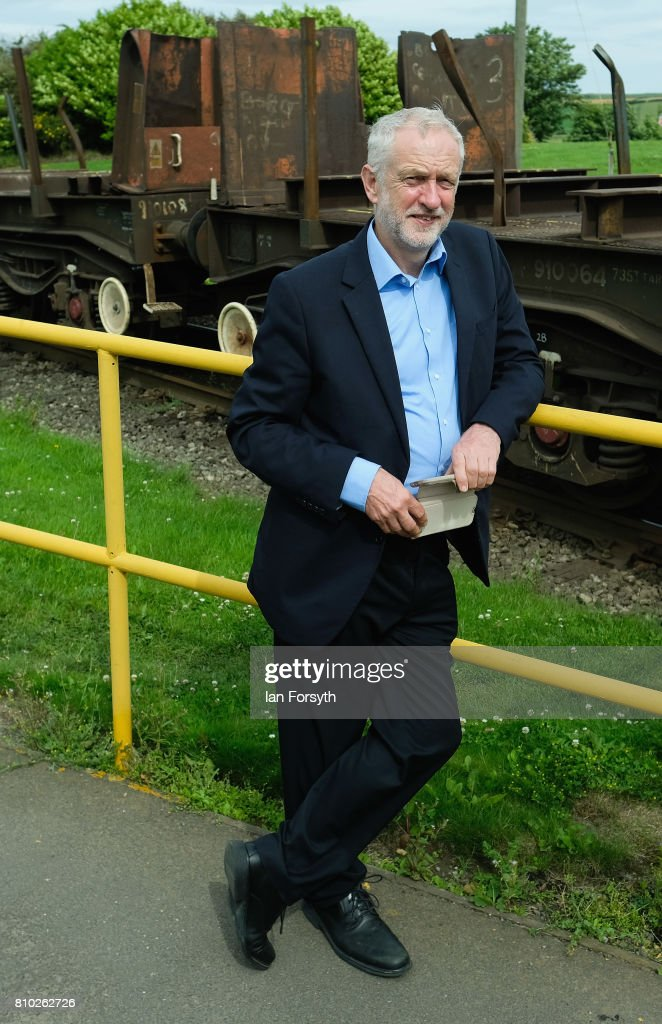 Labour Party leader Jeremy Corbyn waits to cross a railway line during a visit to the British Steel manufacturing site to tour the facility and meet staff on July 7, 2017 in Skinningrove, United Kingdom. The visit was part of a wider tour of the Middlesbrough South and East Cleveland constituency and comes as a recent YouGov survey, the first since the General Election last month, puts the Labour party ahead with 46 percent of the public backing Labour. The Middlesbrough South and East Cleveland constituency was won by Conservative Simon Clarke in the General Election after he beat Labour's Tracy Harvey.
