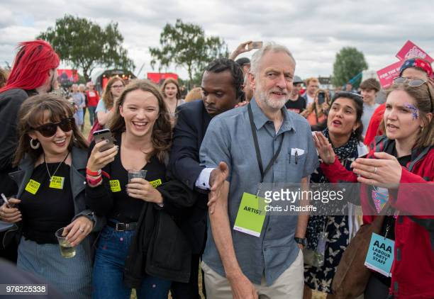 Labour party leader Jeremy Corbyn walks through the crowd before appearing on the main stage at Labour Live White Hart Lane Tottenham on June 16 2018...