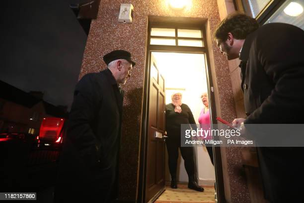 Labour Party leader Jeremy Corbyn with local candidate Matt Kerr whilst canvassing in Govan, Glasgow, during General Election campaigning.