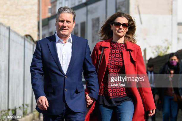 Labour Party leader Keir Starmer and his wife Victoria walk away from the polling station after casting their votes on May 06, 2021 in London,...