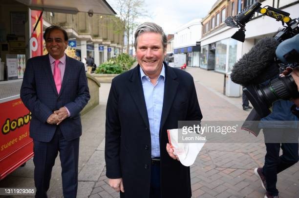 Labour Party leader Keir Starmer receives a bag of donuts as he visits a shopping precinct with MP for Bedford Mo Yasin to highlight the party's...