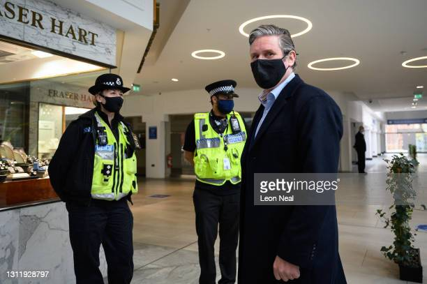 Labour Party leader Keir Starmer speaks to police officers as he visits a shopping precinct to highlight the party's policies on fighting crime, on...