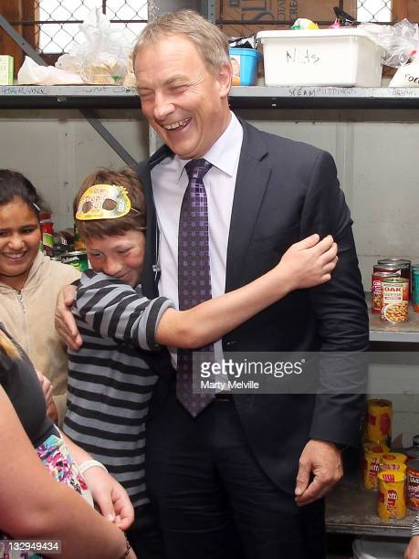 Labour Party leader Phil Goff is mobbed by young volunteers at the Tauranga Food Bank on November 16, 2011 in Tauranga, New Zealand.New Zealanders...