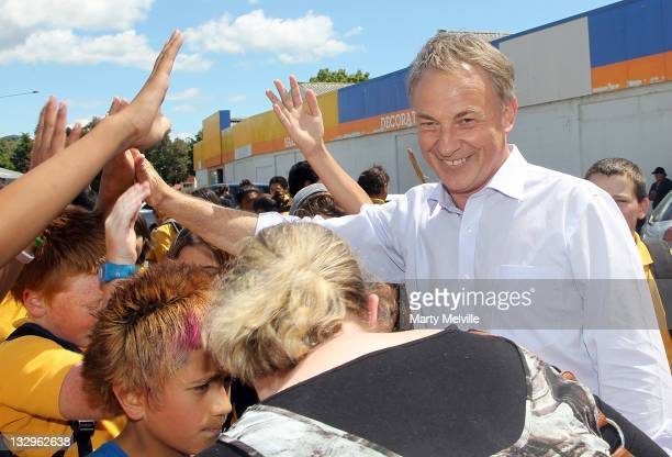Labour Party leader Phil Goff meets young members of Kawerau Intermediate school as they protest to save their school during a campaign visit on...