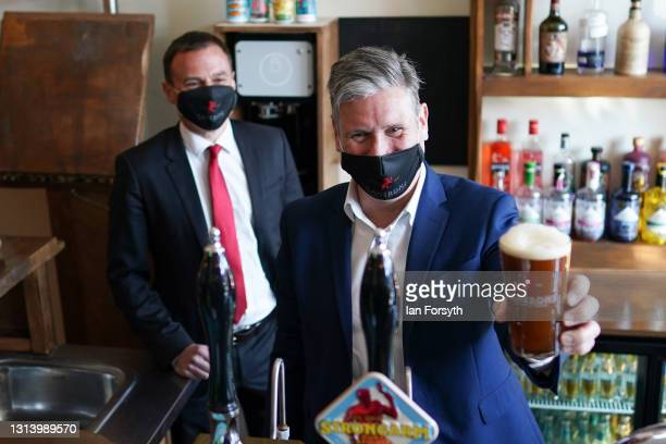 Labour Party leader Sir Kier Starmer pulls a pint as he visits the Cameron's brewery in Hartlepool on April 23, 2021 in Hartlepool, England. The...