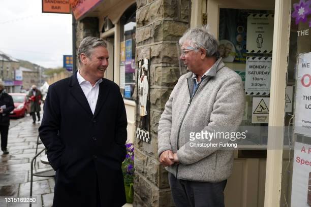 Labour Party leader Sir Kier Starmer talks to shopkeepers whilst campaigning in Rossendale, Greater Manchester on April 29, 2021 in Manchester,...