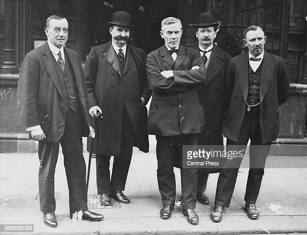 Labour Party leaders Arthur Henderson William Brace William Adamson Vernon Hartshorn and James Henry Thomas outside Unity House during the coal...