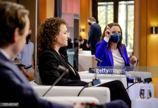 Labour Party member Henk Nijboer, Socialist Party Renske Leijten and Party for Freedom Fleur Agema prepare prior to the first television debate with...