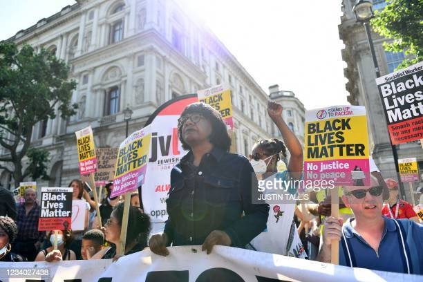 Labour Party MP Diane Abbott joins a demonstration organised by the Stand Up To Racism group outside Downing Street in London on July 17, 2021 to...
