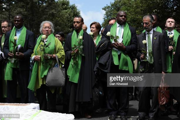 Labour Party MP for Tottenham David Lammy holds a white rose as he pays tribute outside St Helen's Church to mark the one year anniversary of the...