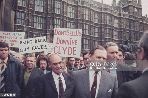 Labour Party politician and MP Tony Benn pictured on far right wearing red tie with shipyard workers from Upper Clyde Shipbuilders as they march in...