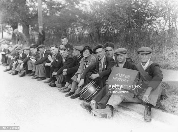 Labour Party politician Ellen Wilkinson, MP for Jarrow, sitting with a group of unemployed men taking part in an unemployment march, Jarrow, South...