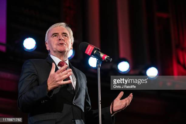 Labour Party Shadow Chancellor John McDonnell addresses an audience of supporters during a rally for the Labour Party following the Queen's speech on...