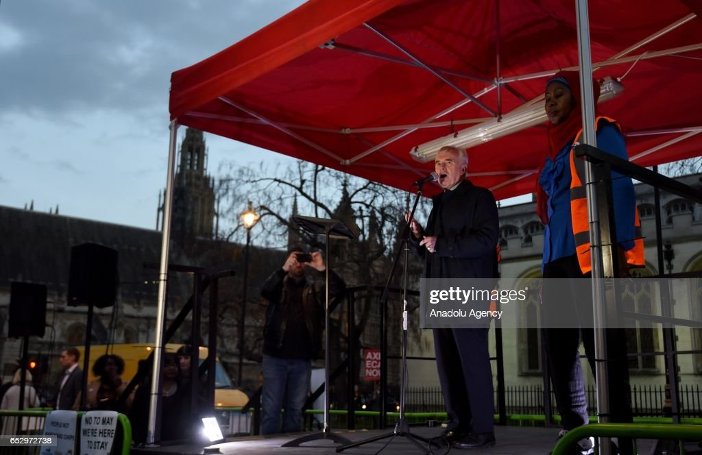 Labour Party Shadow Chancellor of the Exchequer, John McDonnell delivers a speech as demonstrators gather in Parliament Square to support guaranteed legal status for EU citizens in London, United Kingdom on March 13, 2017.